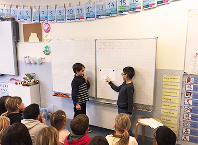 two students teaching a maths lesson