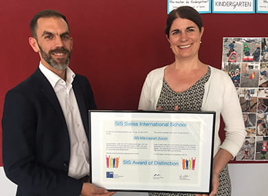 a man and a woman holding the certificate