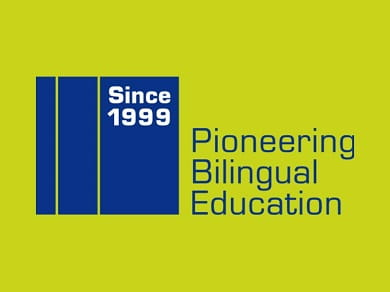 logo of Since 1999 - Pioneering Bilingual Education in blue, green background