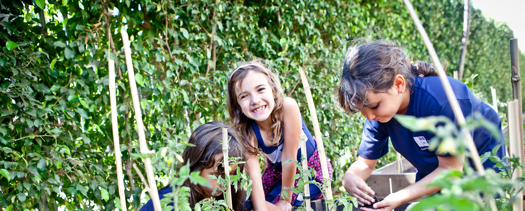 students gardening and girl laughing